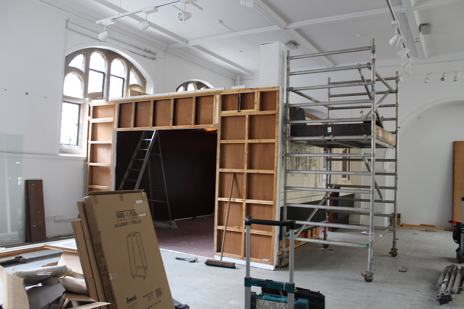 A photograph of the barge in the old museum being deconstructed.