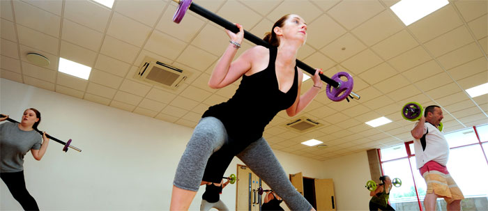 Lady lifting at fitness class