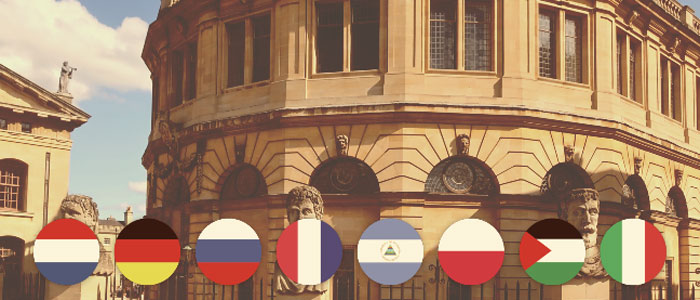 Sheldonian Theatre with Oxford twin town flags