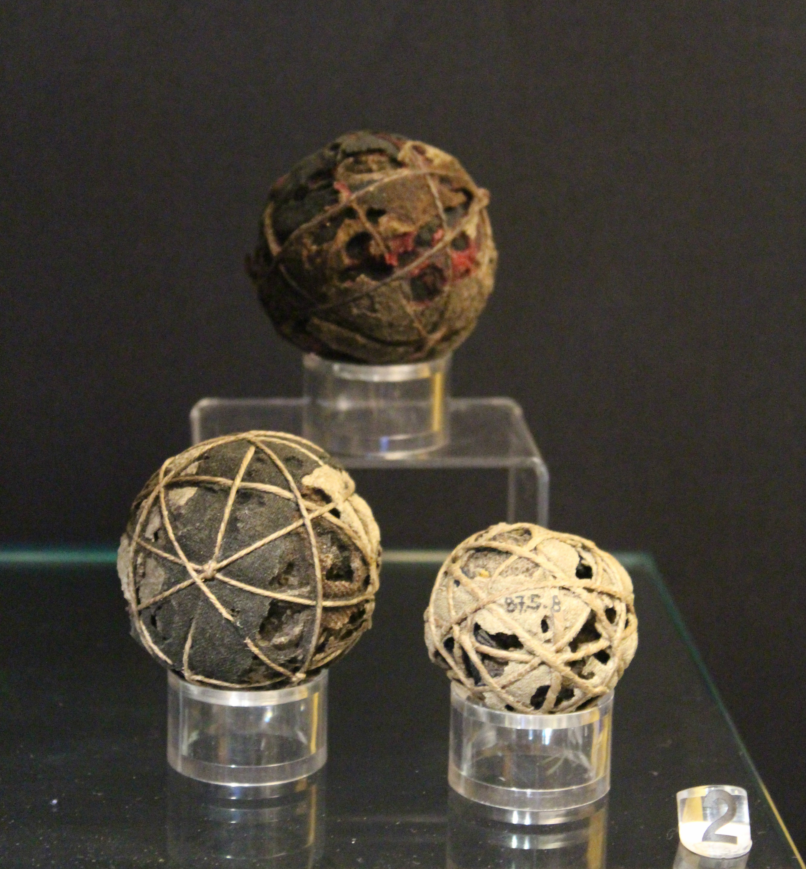 A photograph of three Real Tennis balls which are over 400 years old