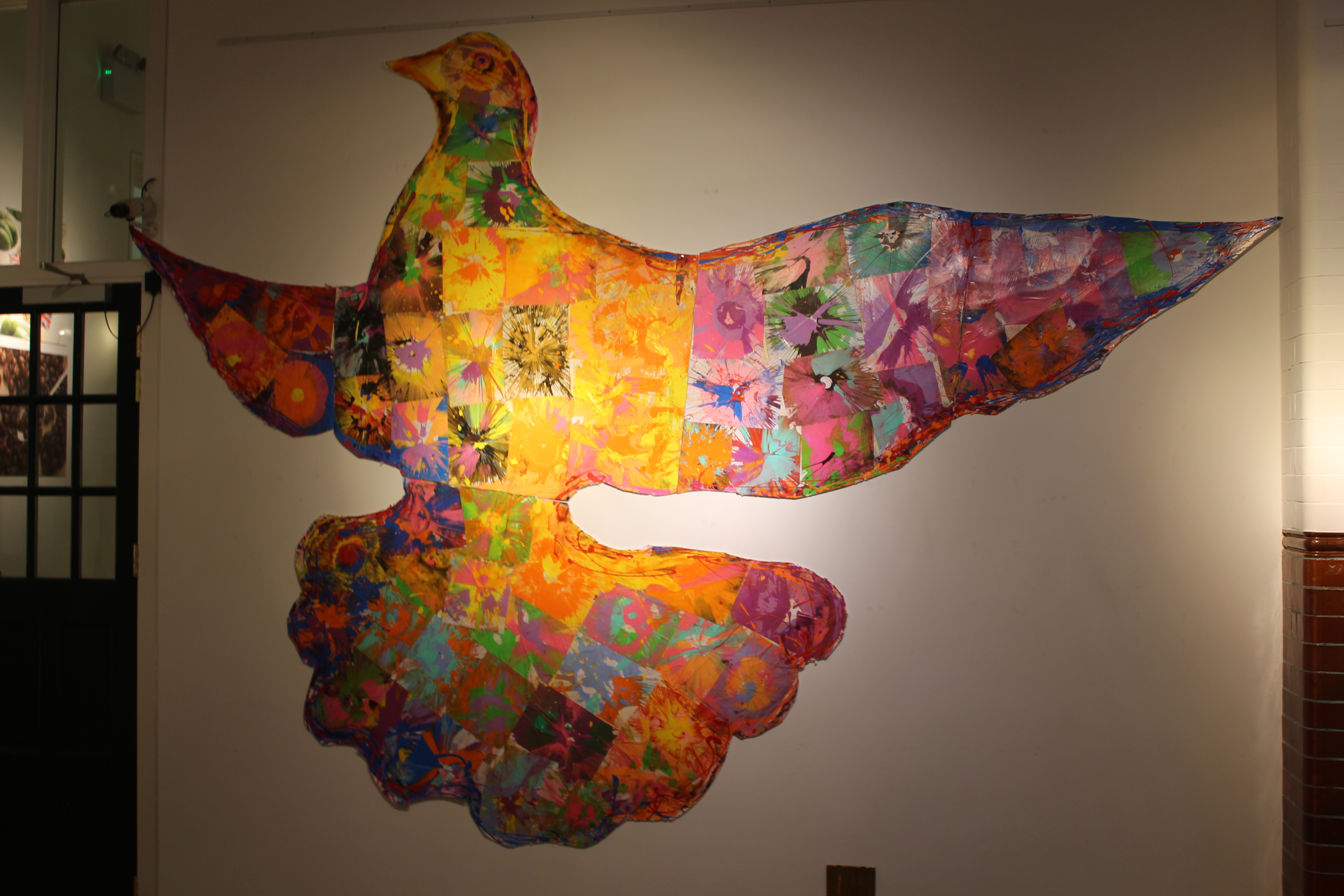 A photograph of a large dove coloured in by spin art
