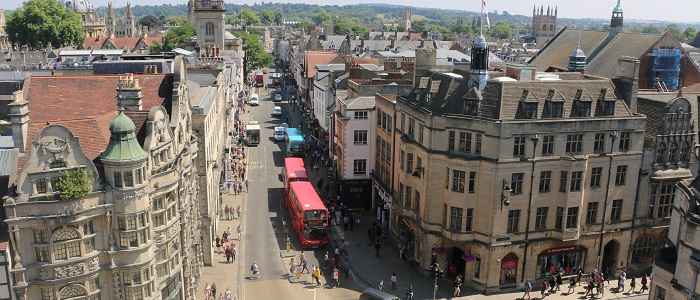 Picture of Oxford city centre taken from the top of Carfax Tower looking down High Street.