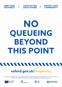 "Image of posters saying ""No queueing beyond this point"""