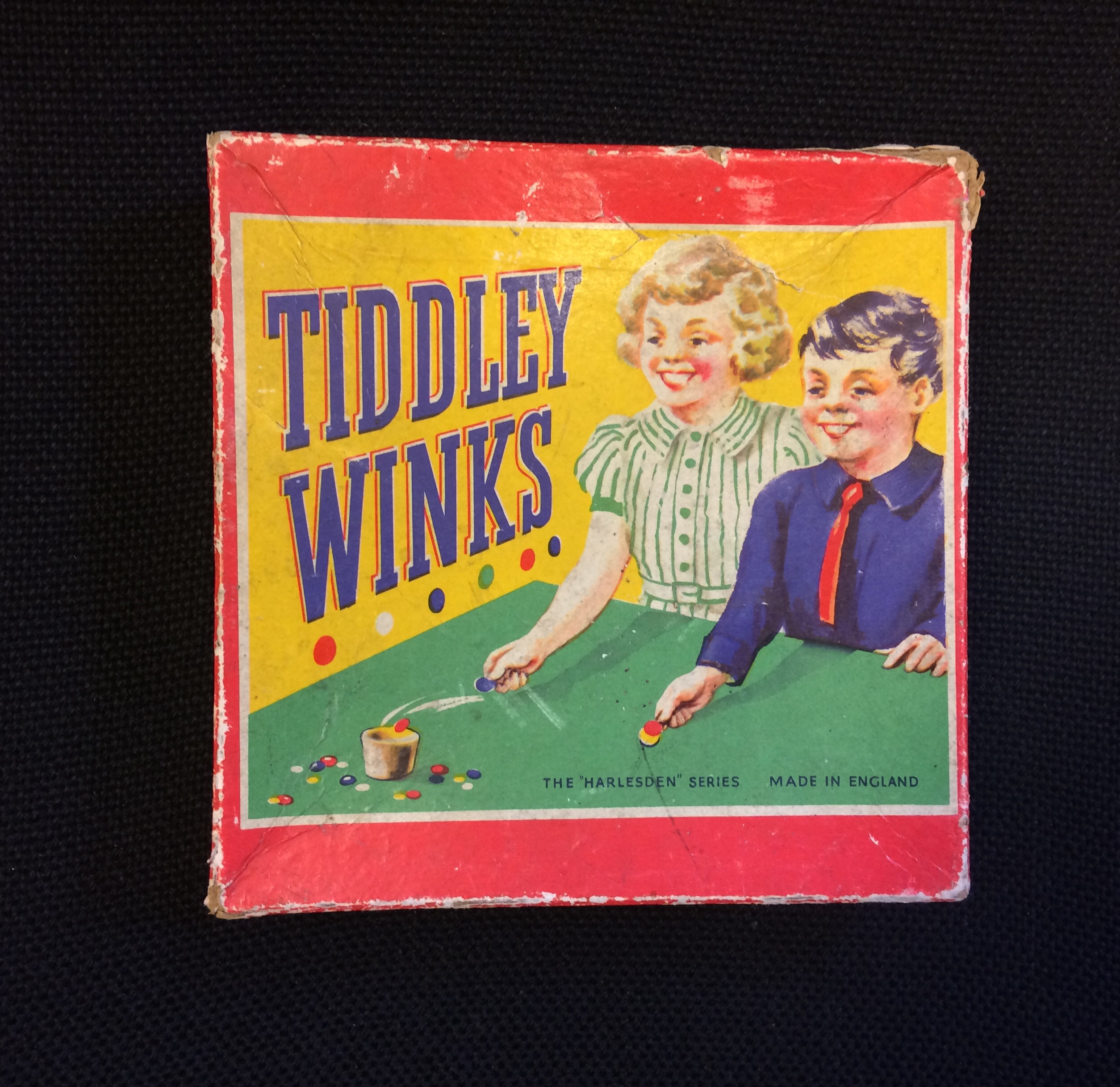 Photograph of a retro and colourful Tiddly Winks game box.