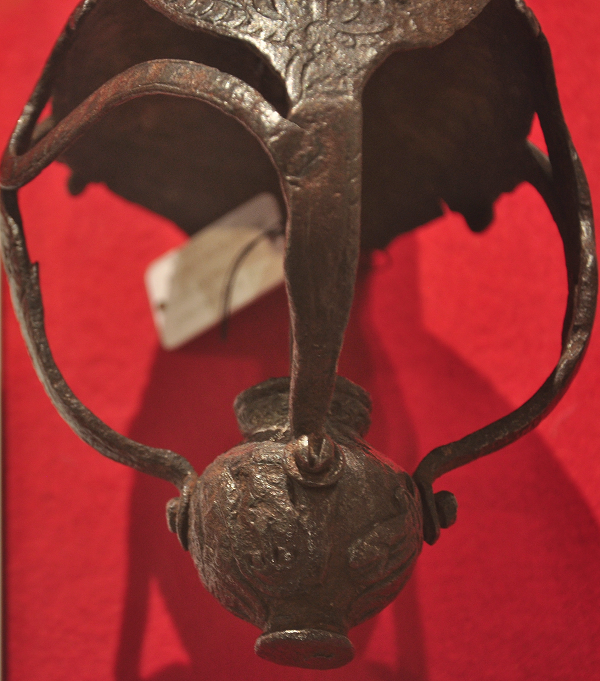 a photograph of the hilt of a iron sword.