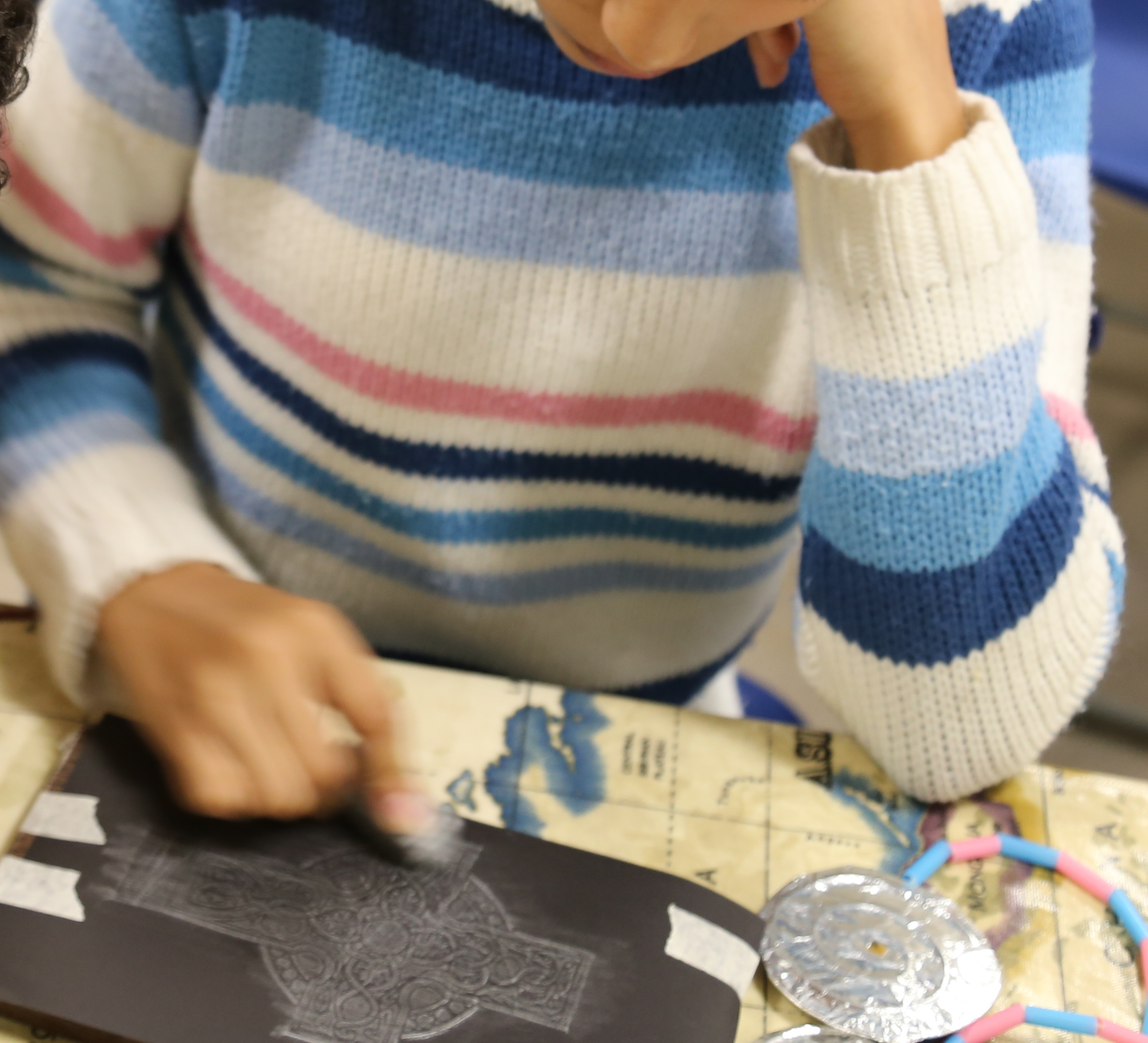 A child doing a brass rubbing