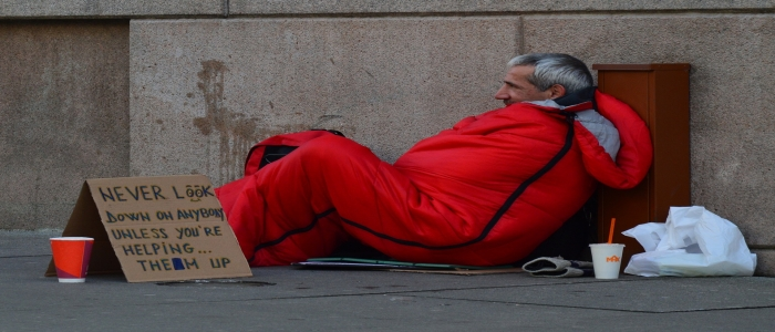 Stock picture of homeless man in sleeping bag